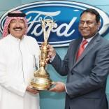 Kalyana Sivagnanam, director of Ford MENA receiving the award from Bakur...